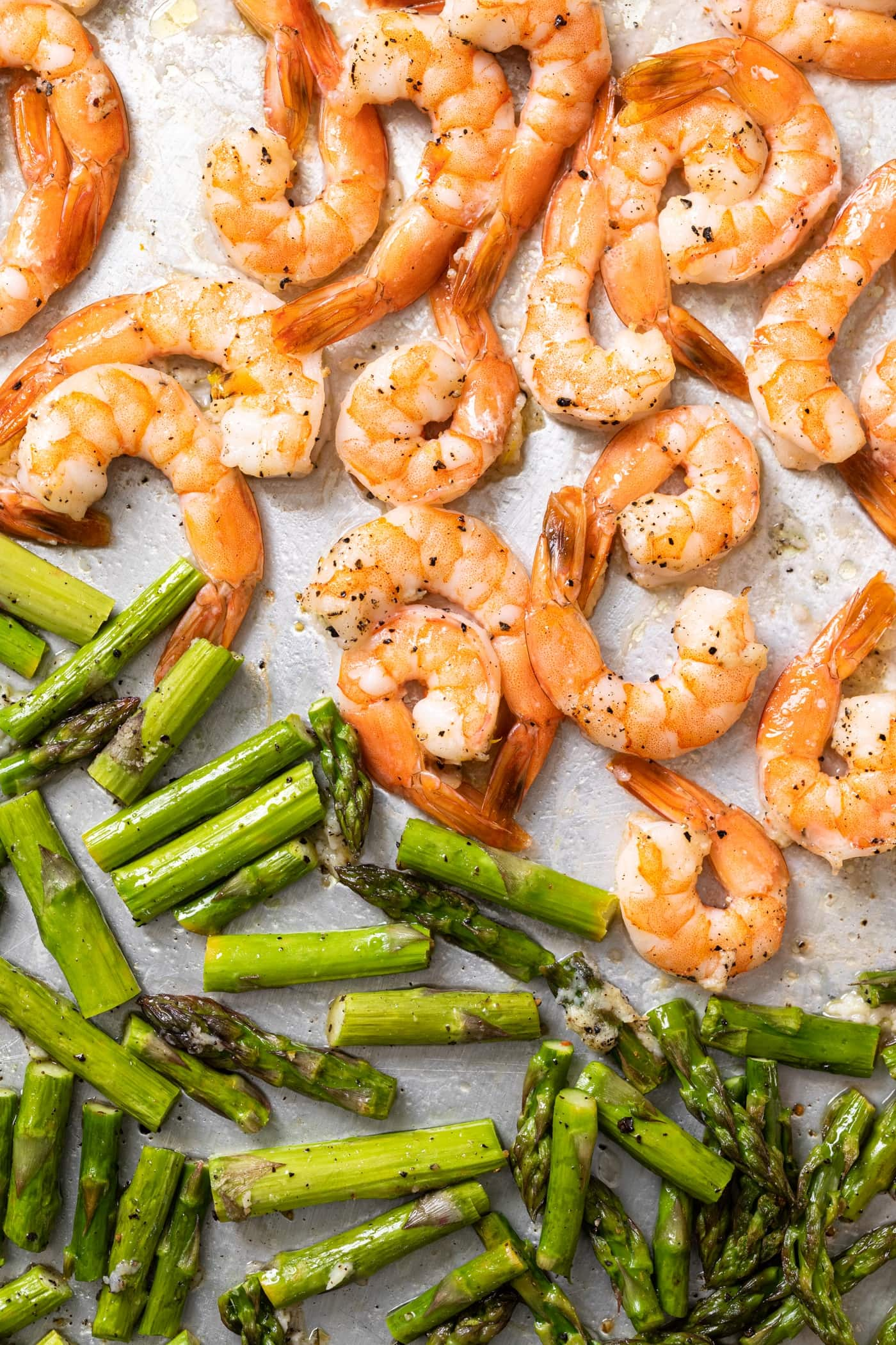 Top down view of sheet pan filled with roasted asparagus and shrimp